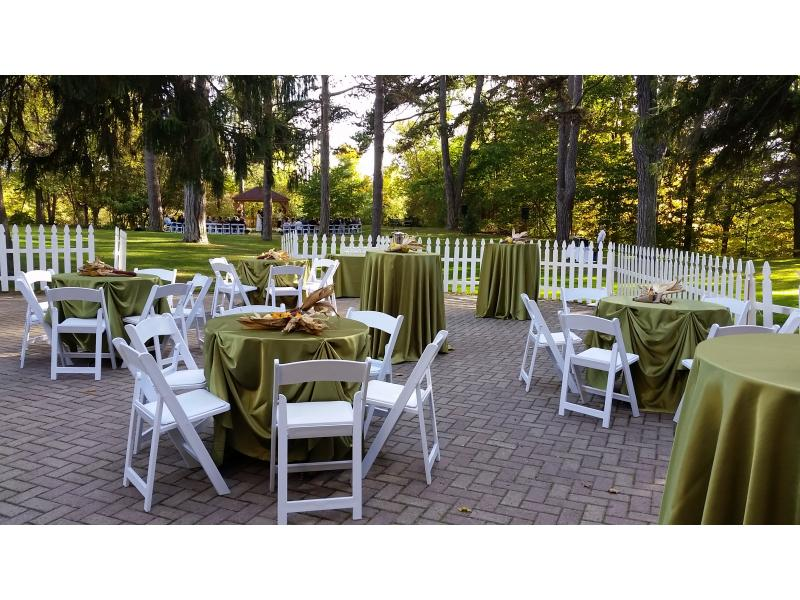 tables setup on a patio with green linens