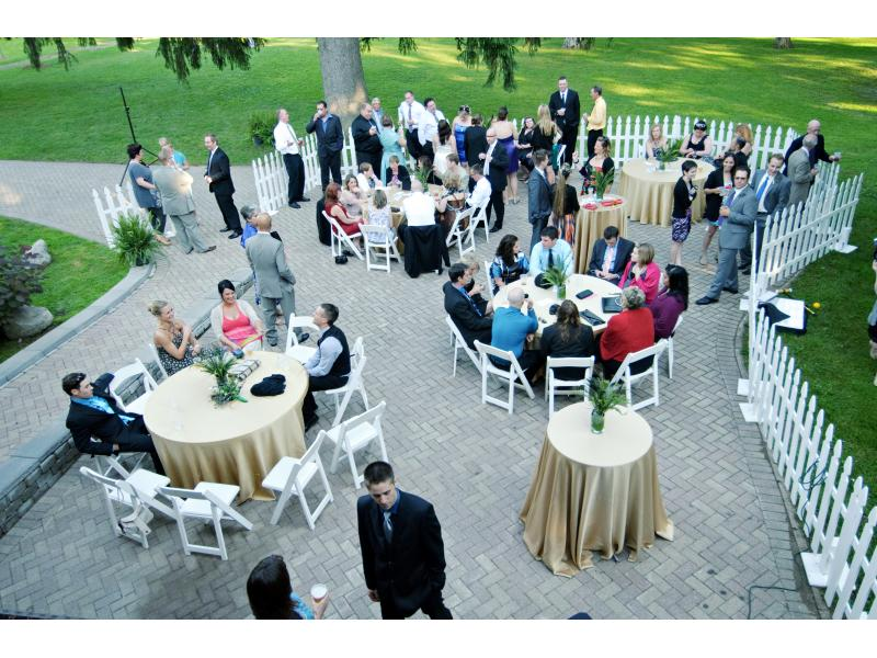 guests enjoying a cocktail reception on a patio