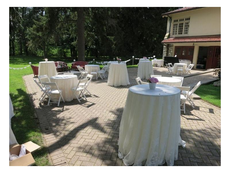 A patio setup with tables, chairs and couches
